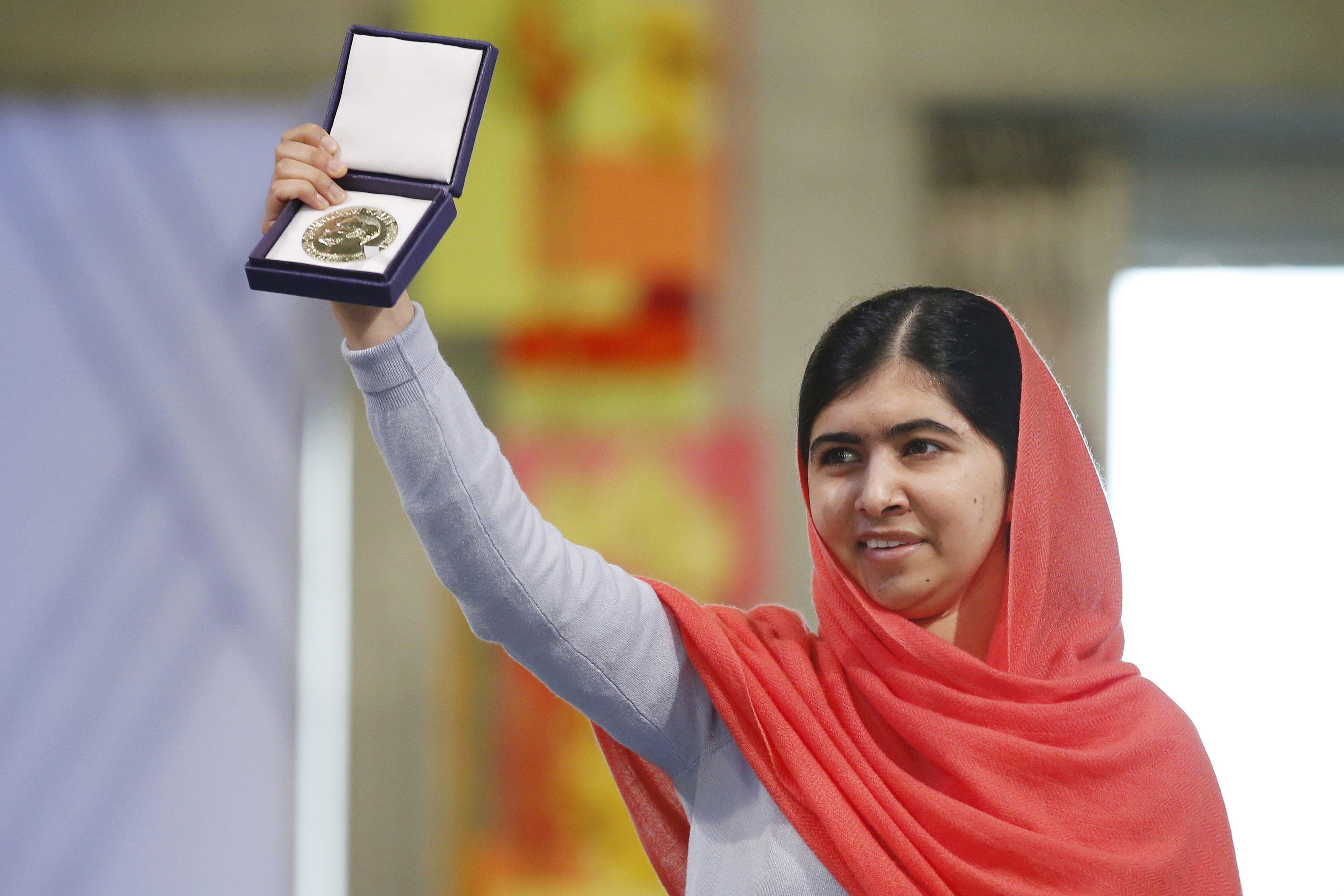 This image shows Malala Yousafzai holding the Nobel Peace Prize.