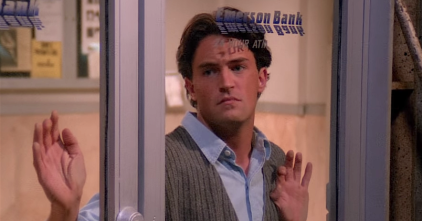 Chandler from Friends pressed up against a glass door.